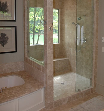 bathroom remodel using natural stone tile and a window in the shower