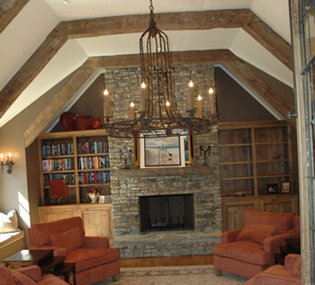 completed interior renovation with fireplace, hardwood flooring & exposed ceiling beams