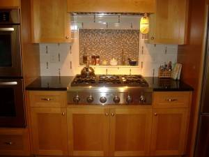 Kitchen remodel with new granite countertops, oak cabinets and stainless steel appliances